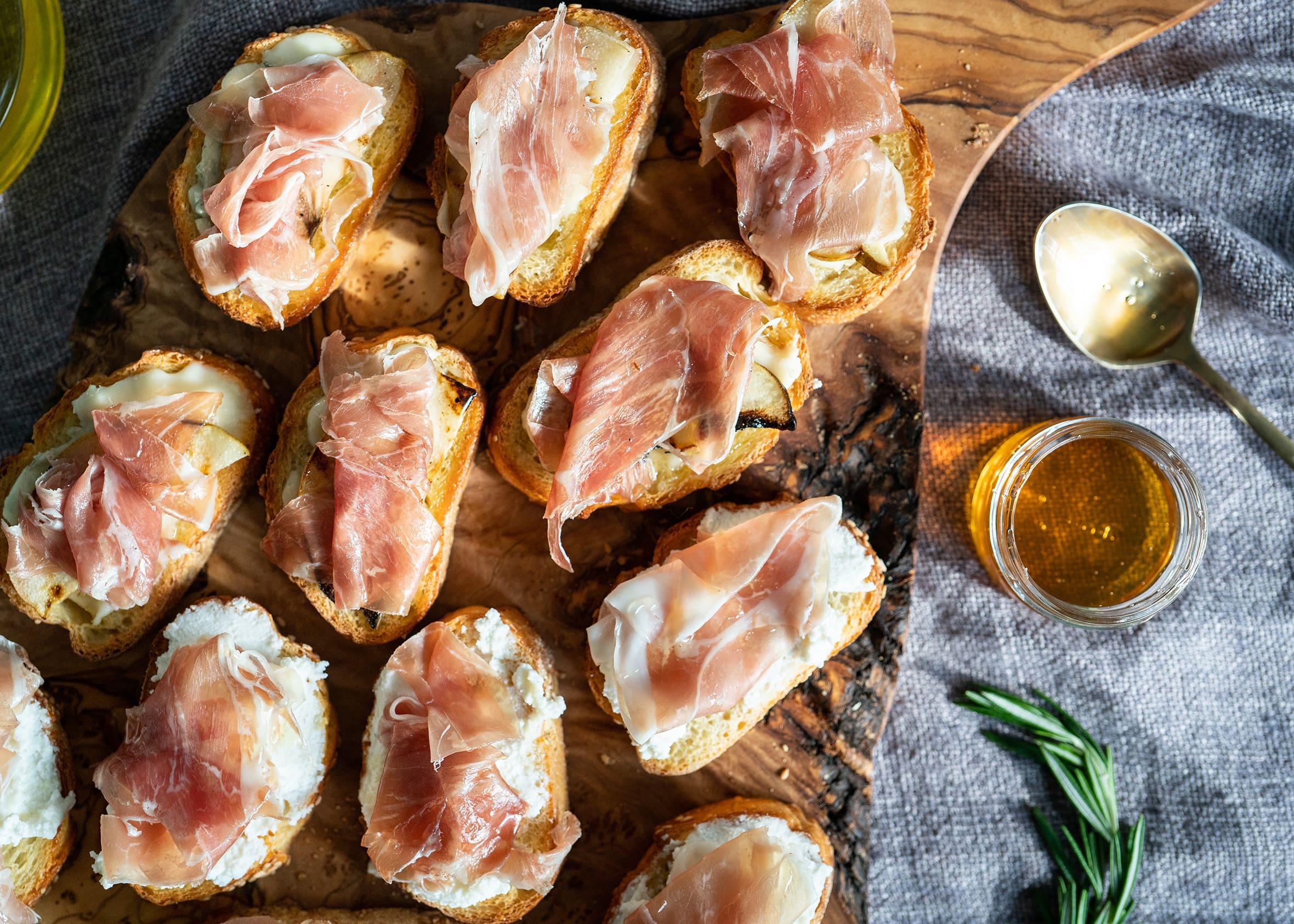 Grilled Pear & Ricotta Prosciutto Crostini